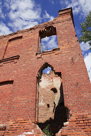 collapsing: Blue sky and collapsing brick wall of ancient building Stock Photo