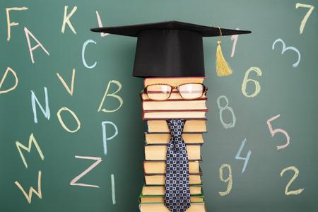 Unusual education idea for grade school with teacher from books Standard-Bild