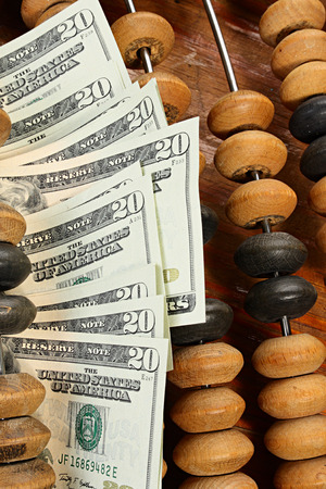 Treasury concept. Dollars and abacus