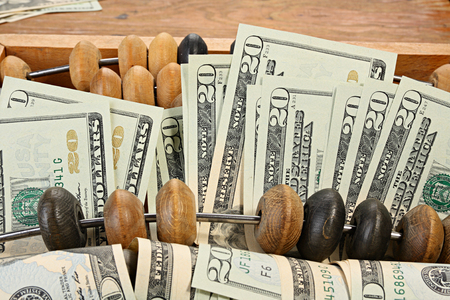 estimation: Abstract treasury concept. Dollars and abacus Stock Photo