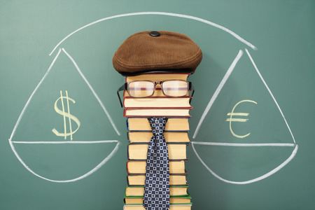 bidding: Unusual funny economist and scales weighing of euro and dollar Stock Photo