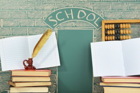 cognition: School unusual concept with books quill pen abacus and with exercise books Stock Photo