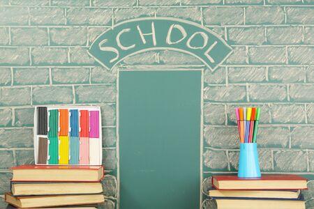 attainments: Grade school unusual concept with books plasticine and felt pen