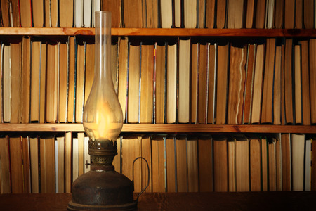 derivation: Light from petroleum lamp in library Stock Photo