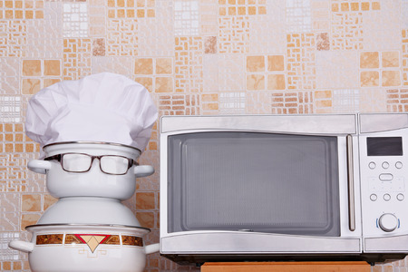Unusual jesting chef about microwave oven