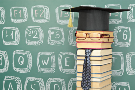 Unusual funny professor with a keyboard drawn on the blackboard