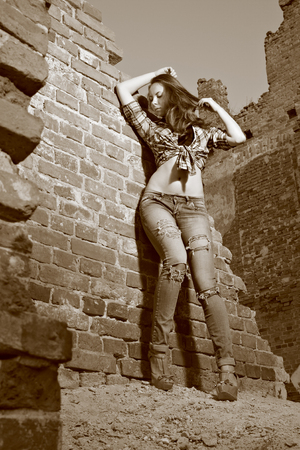 midst: Toned sepia portrait of young women midst old ruins
