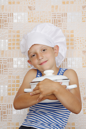prankster: The little funny cook with saucepan Stock Photo