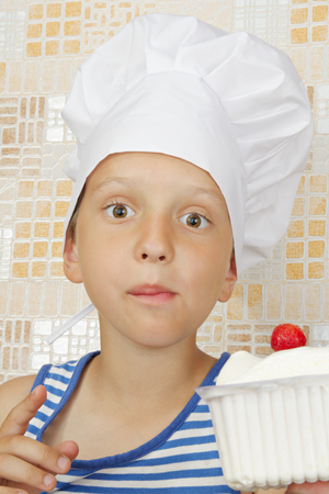 prankster: A little surprised by the cook with ice cream and strawberries