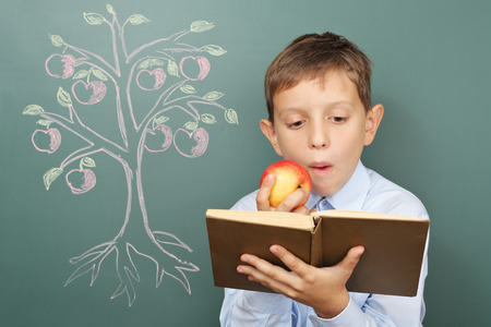 tree of knowledge: Tree of knowledge education concept with boy reading book Stock Photo