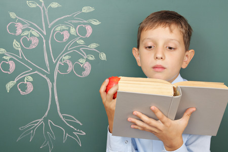 attainments: Tree of knowledge education concept with boy reading book Stock Photo