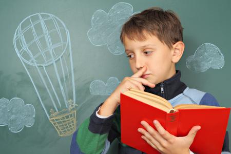 aerostatics: Boy with book dreaming of the sky