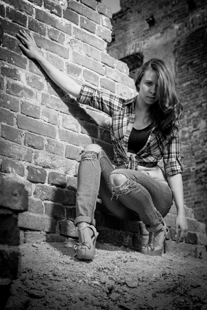 impassioned: B&W portrait of young sexy women midst old ruins Stock Photo