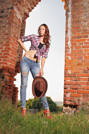 impassioned: Attractive girl on old ruins Stock Photo