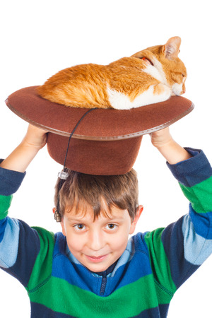 red cat: Boy and his lazy red cat in hat. Isolated on white Stock Photo