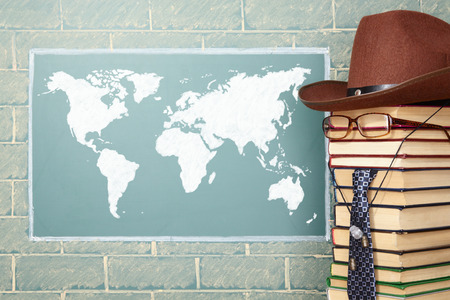 boy student: World map and unusual teacher