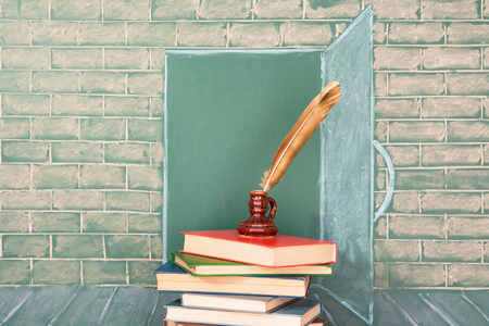 thesaurus: Education unusual art concept with books and quill pen Stock Photo