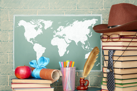 history background: Education idea with unusual teacher before blackboard with World map