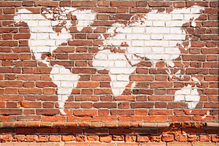 Antique wall from brick with World map graffiti