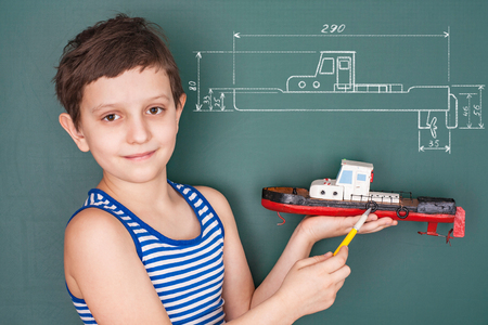 maquette: Schoolboy with his own hand built model boats
