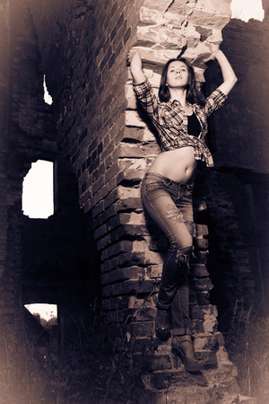 impassioned: Attractive girl as a Caryatid in ruins, split toning and vignetting effect
