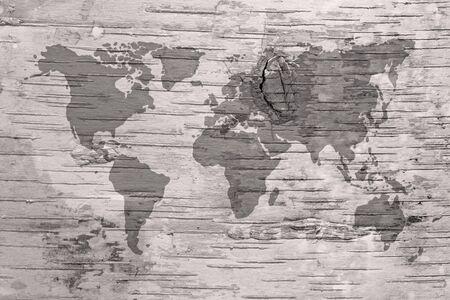 birchbark: Black and white world map on birch cork natural texture background