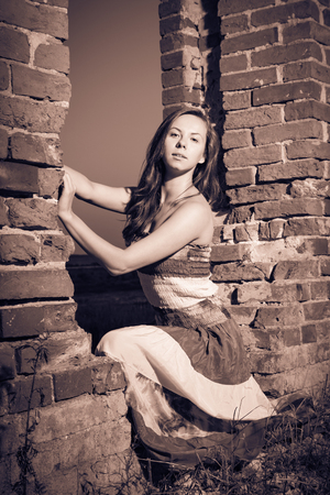 impassioned: Attractive girl in ruins, split toning and vignetting effect