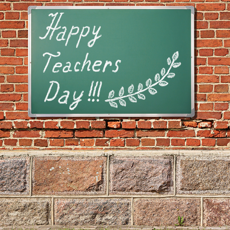 antique sleigh: Education theme. Ancient brick wall with Happy teacher day title on a chalkboard Stock Photo