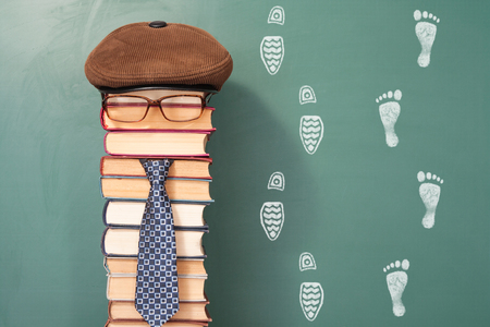 improbable: Funny education concept with the teacher and the traces on the board behind him 3 Stock Photo