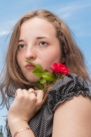 dreaminess: Girl with rose on background of sky