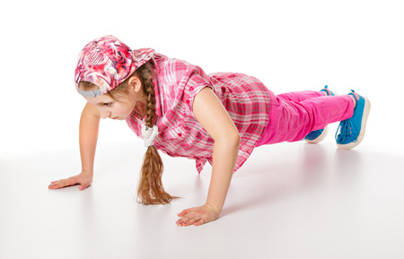 Girl doing push-ups. Isolated on a white background