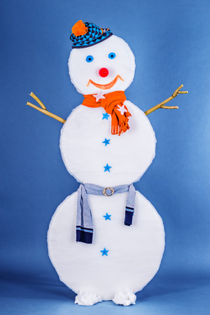 Beautiful funny Snowman in cap and scarf