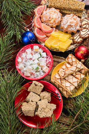 Sweets and decorations on the New Year table Stock Photo