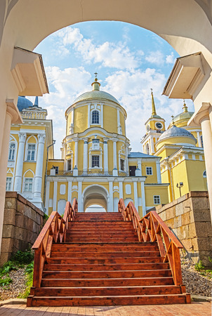 Descent to the pier from the Nilo-Stolobensky Monastery. Beauty view on wood stairs and monastery. Tver region, Russia