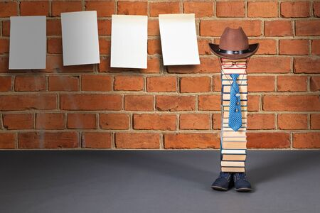 Funny education idea, man teacher and bulletin board on red brick wall Stockfoto