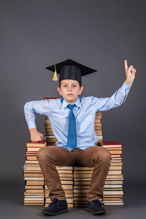 Boy leader sitting on the throne from books, education funny idea