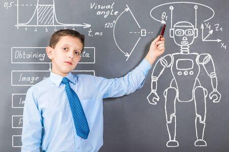 Confident boy demonstrating his knowledge in robotics