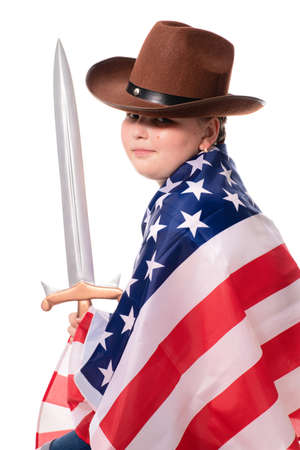 Little strong girl in cowboy hat with american flag and sword. Isolation on white Archivio Fotografico