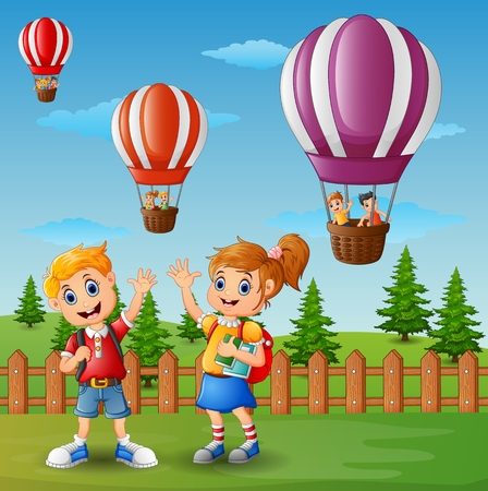 Vector illustration of School of a boy and a girl waving hand outside the fence with a hot air balloon