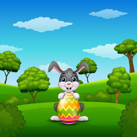 Vector illustration of Cartoon bunny holding easter eggs in the park