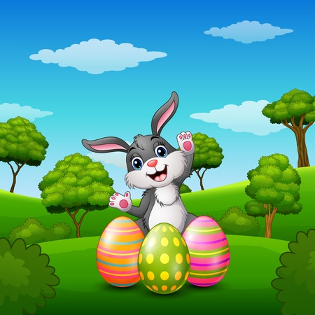 rabbit standing: Vector illustration of Happy rabbit cartoon with easter eggs in the park
