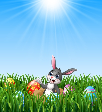 Happy easter rabbit out of holes in the ground with easter eggs in the grass background