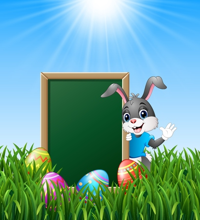 springtime background: Cartoon bunny waving hand with easter eggs and green chalkboard in the grass