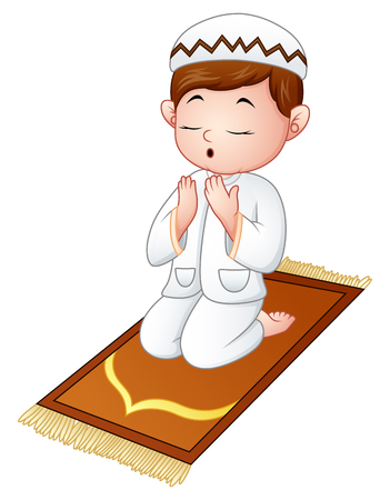 Muslim kid sitting on the prayer rug while praying.