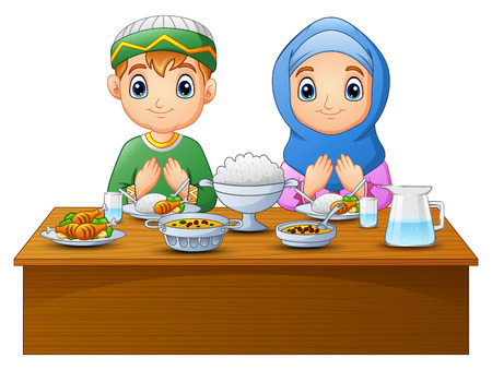 Muslim kid pray together before break fasting Stock Photo