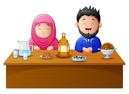 Happy muslim couple break fasting together.