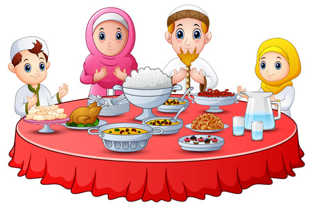 Muslim family pray together before break fasting