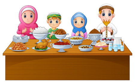 Muslim family pray together before break fasting.