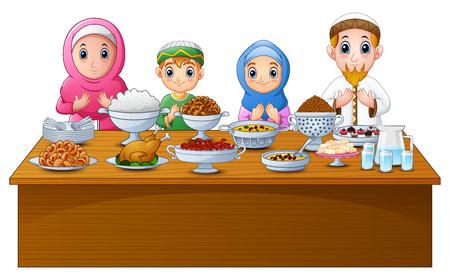 De moslimfamilie bidt samen voor het vallen vast