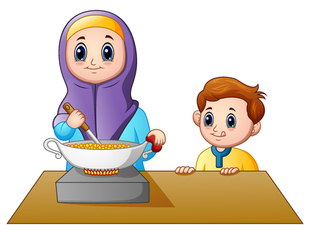 Happy muslim mom cooking with her son Stock Photo